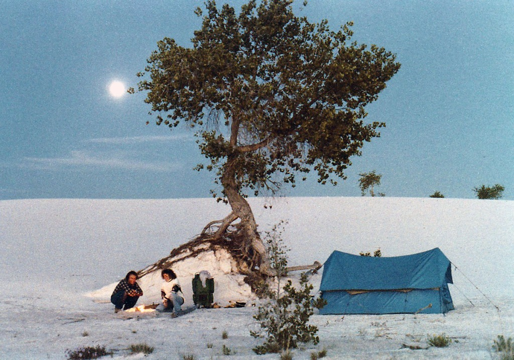 Clem and I at our little fire below one lonely tree with our blue tent under the full moon at White Sands, New Mexico.