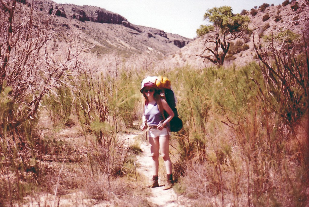 Me and my backpack hiking along the Rio Grande River through dried willows toward Alamo Canyon in the background